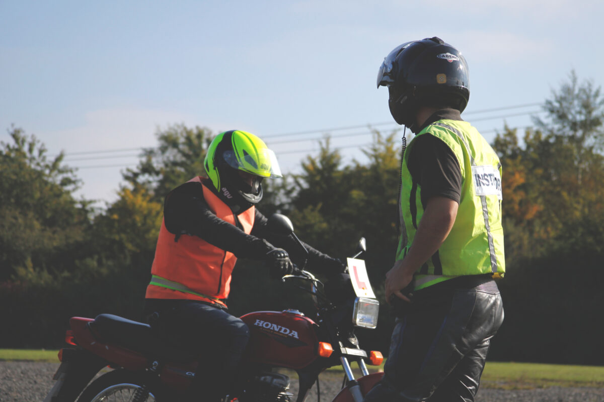 An Able Rider Training instructor with a student